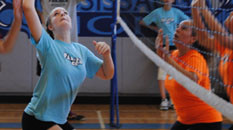 A girl about to hit a volleyball