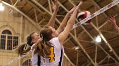 2 Volleyball girls blocking