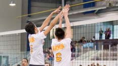 Pakmen plus volleyball players performing a double block