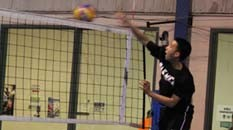 Pakmen plus volleyball player hitting the ball