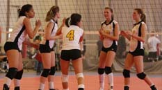 A group of volleyball players standing around
