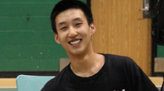 A volleyball player smiling