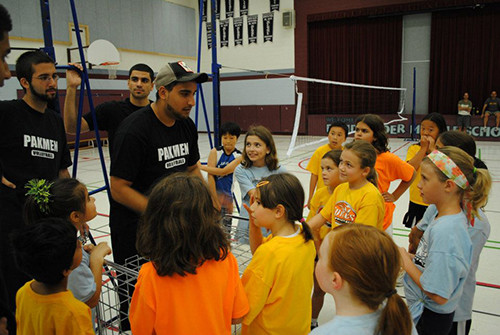 A volleyball coach with his players