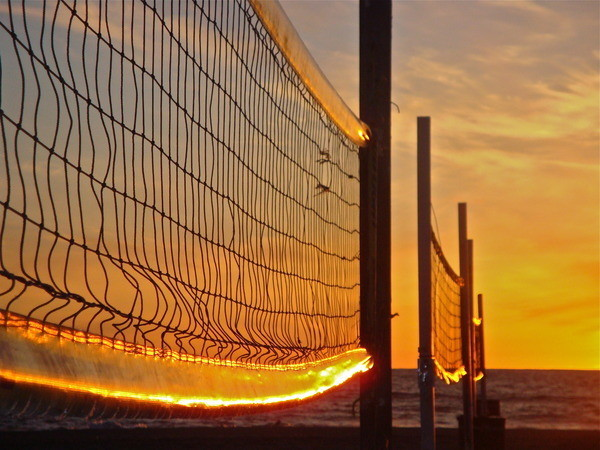 3 volleyball nets and sunset