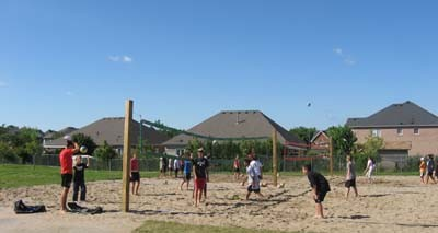 Players on the David Leeder beach volleyball courts