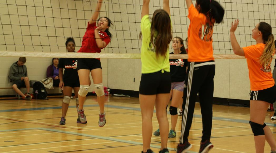 Girls playing at volleyball camp